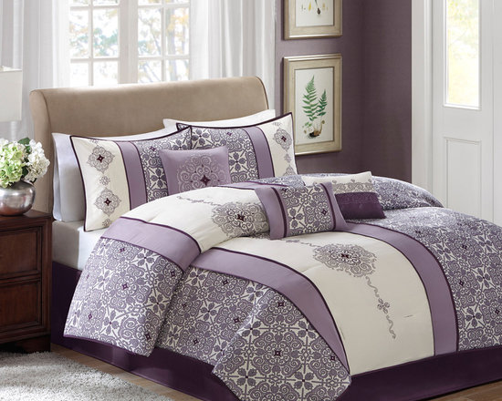 Madison Park - Madison Park Donna 7 Piece Comforter Set - For an updated look, the Donna collection will make a statement in any home. The comforter and sham features a tonal purple geometric pattern is print on soft microfiber and reverses to solid purple color. The geometric motif is enlarged and embroidered asymmetrically on the comforter and accented with stripe details. The set includes a solid purple bedskirt. The three decorative pillows includes embroidery and pleating details in tonal purple colors. Comf & sham face: 100% microfiber printed and pieced with emb on TOB. back: 100% polyester microfiber; filling: 200gsm poly fill; Bedskirt drop: 100% polyester micro fiber 75gsm, platform, nonwoven; Pillow: 100% polyester cover with poly fill