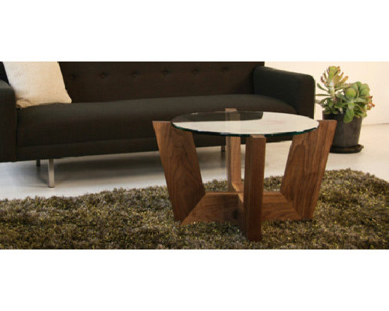 Viesso Brand Furniture - Open design for the open mind. This modern round coffee table uses a very open, airy base with a floating top. The result is a wide storage area with minimal visual obstruction. No matter what solid wood you choose, American Red Oak or American Walnut, you'll end up with a unique piece, comfortable with many other styles.