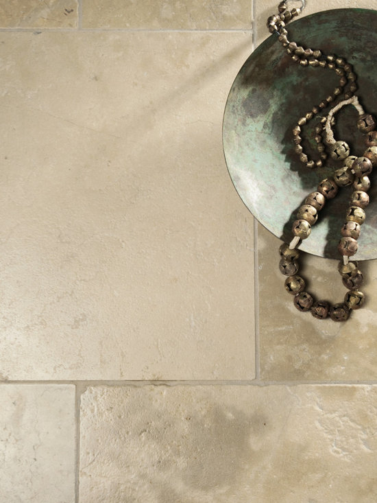 Royal Stone & Tile Showroom - Like Nova Blue, Nova Gold is a Portuguese limestone featuring a sandy-like, mottled mineral surface that adds texture and visual interest. Golden highlights on a beige background create a shimmering effect.