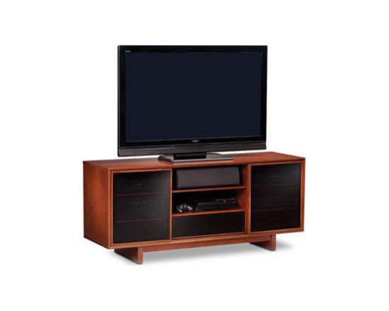 Furniture - Perfect for use with large TVs, CIRRUS is available in two models. Both feature sliding wood-framed doors with IR-friendly grey tinted glass that conceal two side compartments. The center compartment provides the ideal space for a center channel speaker and/or additional components. The console height model also includes a media storage drawer to keep everything neat and organized.