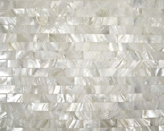 Shell Tile Mosaic Wall Tile - This lovely shell mosaic subway-style tile could really bring some inspiration when decorating a bathroom.
