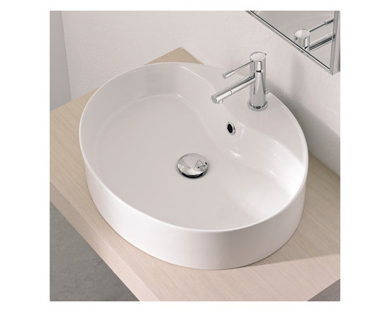 "Scarabeo - Sleek Oval Shaped White Ceramic Vessel Sink by Scarabeo - Sleek contemporary above counter vessel sink designed and manufactured in Italy by Scarabeo. This oval shaped bathroom sink is made of high quality white ceramic. Washbasin includes overflow and a single faucet hole. Sink dimensions: 21.30"" (width), 5.30"" (height), 17.70"" (depth)"