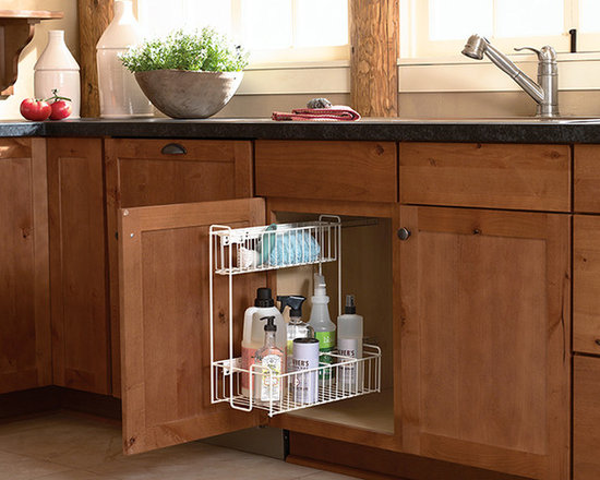 Sink Storage Pull Out - This pull out makes good use of the awkward space under the sink, storing cleaning tools and supplies until needed.