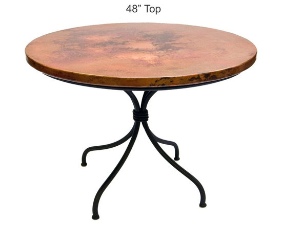 """Mathews & Company - Italia Dining Table with 48"""" Round Top - Delight family and friends with the pleasing lines and striking features of this classic dining table. The smooth, polished iron base perfectly sets off the bright tones and rich texture of the hand-fired copper. Four sturdy legs, wrapped and welded together at the center provide a steady base for the roomy table top. The patterns in each copper piece we fire are slightly different and all one-of-a-kind. With its lasting beauty and interest, you will never need to cover this table with a cloth, but can leave the craftsmanship of our artisans on full display. Pictured in Copper top and Black finish."""