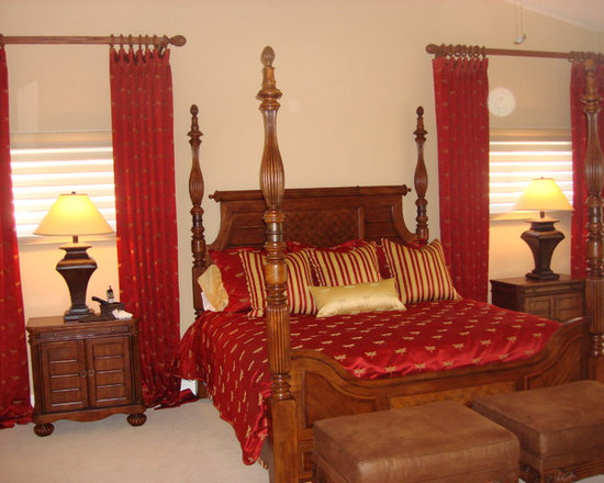 """Fly-In home - HunterDouglas Silhoettes under stationary panels on 3"""" wood poles and finials matching stain on bed. Custom duvet cover with dustruffle and matching pillows and bolster."""