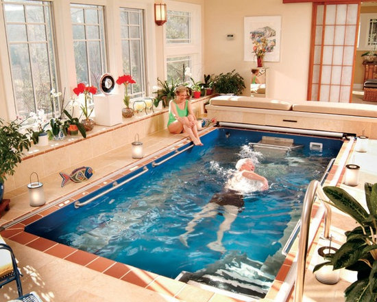 "Endless Pools - Original Endless Pools®, Indoor Swimming Pool - All Endless Pool components can fit through a 24"" doorway, down stairs and around corners.  Install the Endless Pool anywhere in your home and enjoy the benefits of swimming an water exercise year-round."