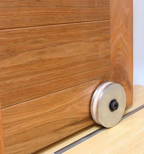 Barn door hardware bottom roller traditional barn door for Sliding barn door rollers