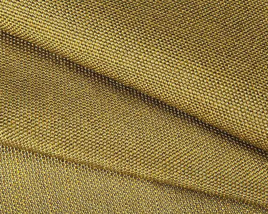Basica Textured Upholstery Fabric in Sage - Basica is a sage green textured upholstery fabric with an interesting, nubby weave perfect for upholstering large scale pieces. The solid colorway works perfectly as a base fabric for any interior design. This fabric has an earthy, natural feel. American made from 100% rayon. Width: 54″.