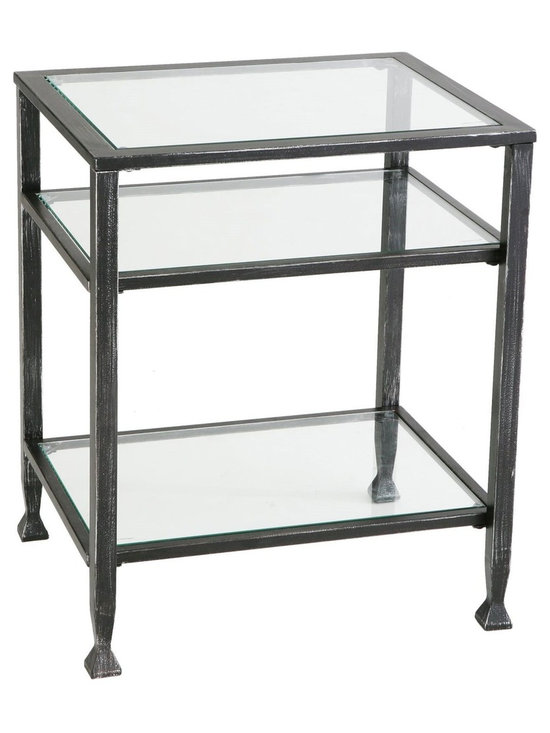 "Holly & Martin - Holly & Martin Guthrie Metal End Table X-10-3-420-311-10 - Create an elegant atmosphere in your home with this sleek contemporary end table. The solid metal frame is constructed of square tube with flared feet. This end table is 24"" tall, has one shelf that sits 6"" above the ground and one that is recessed approximately 6"" below the top creating a shadowbox effect that is perfect for books, potpourri, or collectables. The top and two lower shelves are inset with solid pieces of tempered glass while the frame is finished with brushed black paint. Use this contemporary end table to accent the d&#233:cor in your home.     - 16"" W x 20"" D x 24"" H                                                                                 - Distressed black finish                                                                               - Two shelves for storage and display                                                                   - Durable metal and tempered glass construction                                                         - Supports up to: 25 lb. (tabletop), 15 lb. (per shelf)                                                 - Assembly required"