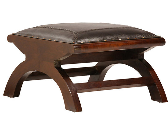 Lazy Ottoman - A sophisticated choice, this lazy ottoman is crafted from solid teak and upholstered in hand-finished full grain leather. The gracious arched design of the base lends elegance and movement to the ottoman while exceptional attention to details - such as the antiqued brass nail head trim - brings classic refinement. This eye-catching ottoman is available in your choice of two sealed finishes: antique brown and dark brown.