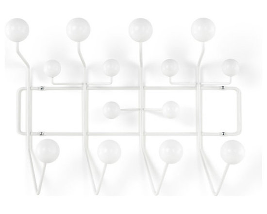 Herman Miller - Eames Hang-It-All Rack - The Herman Miller Eames Hang-It-All takes the everyday coat rack to a new place that was inventive and fun. The Eames Hang-It-All from Herman Miller will hold anything that can slip over its colorful hooks. The Eames Hang-It-All features a welded steel frame with a white powder-coated finish. The colorful hooks are solid maple balls in nine different colors. The Herman Miller Eames Hang-It-All is perfect for holding your hats or jackets and more.