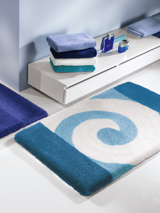 Aqua Blue - Aqua and green toned blues are all the rage this year.  They add a fresh feel to any space.  Our contemporary swirl pattern bath rug is called Filou.  Deep aqua tones on the end and a lighter blue tone with white in the center.