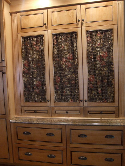 Maple cabinet doors with fabric panel inserts. traditional-storage-and ...