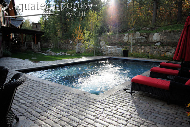 Jackson Hole Wyoming patio pool with an automatic pool cover traditional-hot-tub-and-pool-supplies