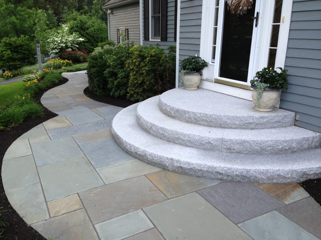 Curving bluestone walkway with radius granite steps for Exterior stone stairs design