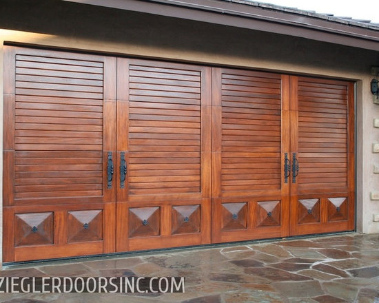 Solid Mahogany Garage Door in a Mediterranean Style With Louvered Paneling -