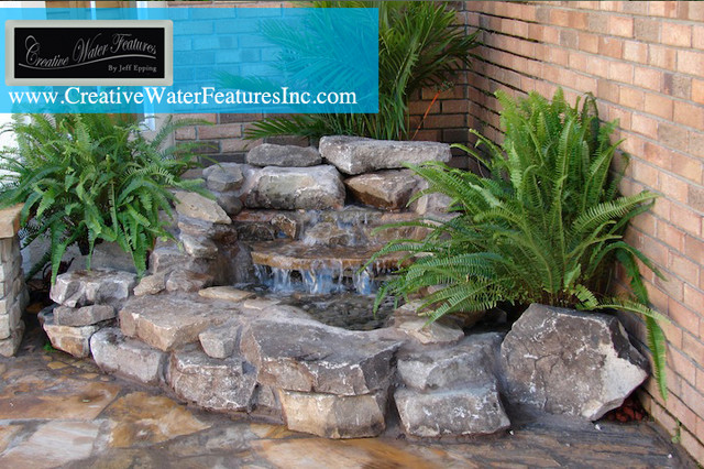 Small pool waterfall - orlando - by Creative Water Features Inc.