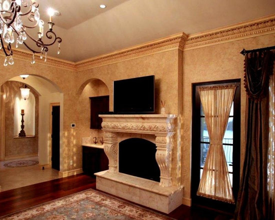 Fire Mantels - Cast stone fireplace mantel and over mantel design in smooth and travertine finishes.  Custom floor to ceiling mantel designs.