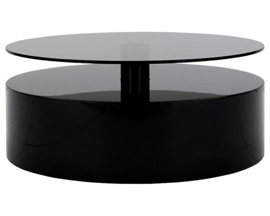 Minotti - Minotti Perrish Coffee Table - Whether in front of the sofa or more in the background, next to it, Parrish enjoys being there and showing up.  It is a coffee table with character.  It sticks to the ground through a series of cylinders; whereas the top is available in serveral different versions: pewter-finished, lacquered, laser-cut sheet metal or smoke grey glass, depending on whether you want to established an anology or contrast focused relationship.  Available in three sizes; one of which has two shelves. Price includes shipping to the USA.  Manufactured by Minotti.