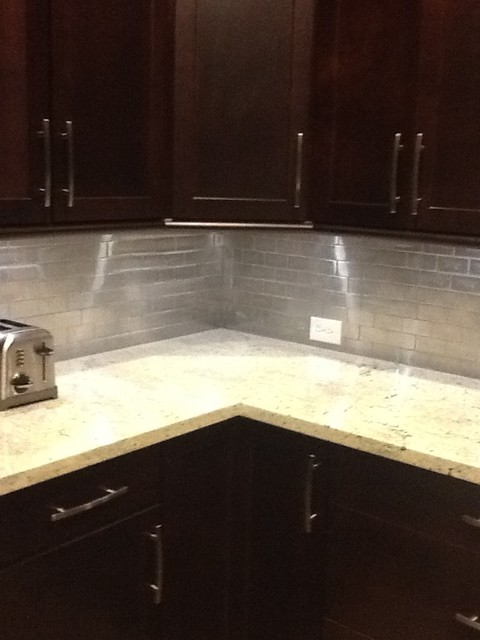 our completed backsplash stainless steel with kashmir