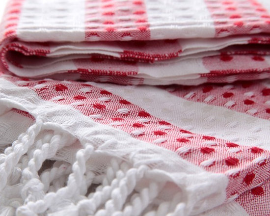 Turkish Hammam - This very fine woven Turkish cotton towel is made of 100% cotton. There are red and white dotted light red stripes in equal thickness on the waffle patterned fabric. The two ends of pestemal is composed of white tassels.