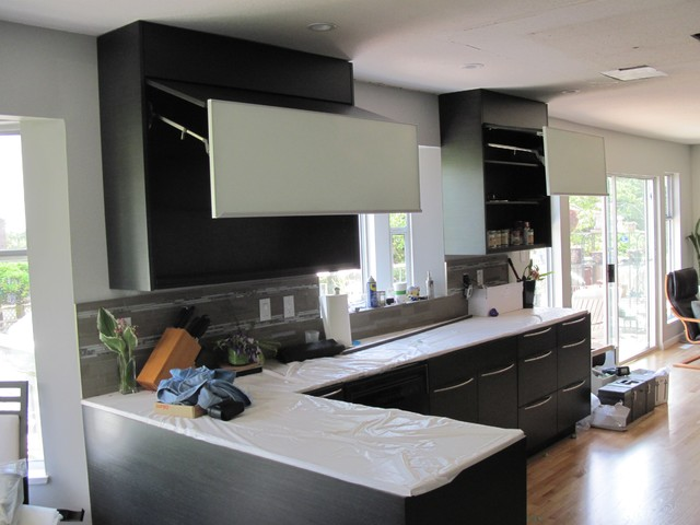 Black oak flat panel cabinets for Flat black kitchen cabinets