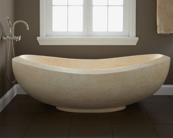 Color! - Made of polished Sunny Gold Marble, the magnificent and spacious Lucius Freestanding Tub offers a grand presence in your master bath. With its light-salmon shade, the Lucius is unique thanks to natural variations in the marble.