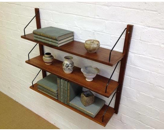 """Mid Century Cado Style Wall Shelving - Mid Century modern Cado style hanging shelves and rails. These interchangeable shelves are perfect anywhere in your home or office. Easy to attach to the wall and once they are up, they have an awesome floating look. The last photo shows a similar set (stock photo) affixed to a wall but the brackets go through the wood - on the set I have the shelf sits in the 'nook' (hard to photograph on the ground). Two sets available, $295/each set which includes 2 shelves, 2 rails and hardware to hold the shelves. Purchase both sets for $550. Purchase both sets to combine them into a longer or wider unit or to use in two separate areas. One set has two 12""""/deep shelves and the other set has an 8""""/deep shelf and one 12""""/deep shelf."""