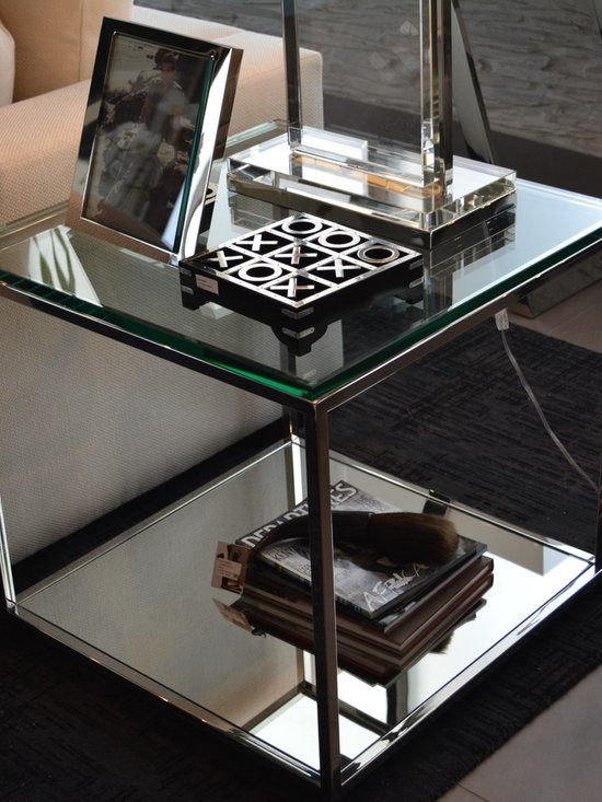 Showroom Pieces - Silver mirror side tables now on our floor.