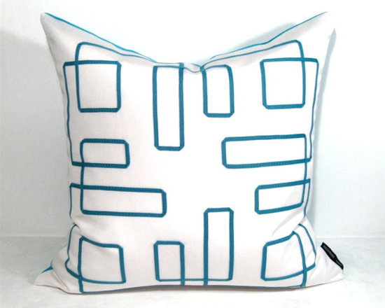 White Turquoise Mazing Outdoor Decor Cushion - This bold pillow features decorative blue trimming in a modern greek key inspired design so popular in interior design. Crafted from white and bright turquoise Sunbrella outdoor canvas for the boat, patio, pool side or any stylish space - indoors or out! Fully finished inside with a reinforced, weather proof zippered closure. Cover or bring indoors when not in use for longevity.