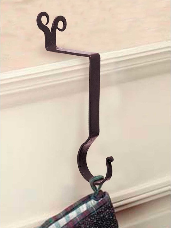 Renovators Supply - Stocking Holders Black Iron Stocking Holder Ram's Horn 10'' H - Stocking Holder. Wrought iron stocking mantle holders, a terrific way to display holiday stockings & bring JOY & CHEER to your home. STOP using nails or tacks on your mantle, rather use this handy damage-FREE stocking holder. RSF powder coating protects this hanger for year to come. A GREAT gift idea too! Use this holder year round to display dried flowers & Easter baskets! Measures 10 in. high.
