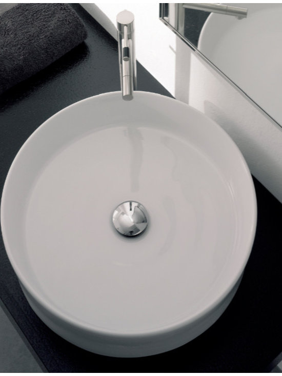 "Scarabeo - Luxurious Contemporary Round White Ceramic Vessel Sink by Scarabeo - Contemporary above counter vessel sink made of high quality white ceramic. Designed and manufactured in Italy by Scarabeo. Luxurious round washbasin comes without overflow and has no faucet hole. Sink dimensions: 17.70"" (width), 5.10"" (height), 17.70"" (depth)"