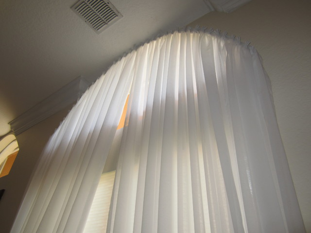 Yardena | Arch Window with Pleated White Sheer Drapes modern-curtains