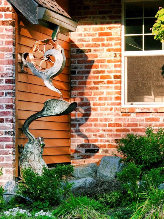 Copper Water Wheel with Frog - A water feature and downspout built into one system. Water wheel frog has an overflowing water reservoir that let's you play even without the rain.