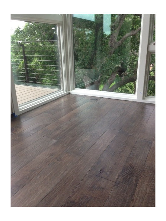 "Southern Pecan - This is a 4-7"" random width Southern Pecan floor. The client wanted to match the trees right outside the window, so we white washed and stained several samples to get as close as possible."