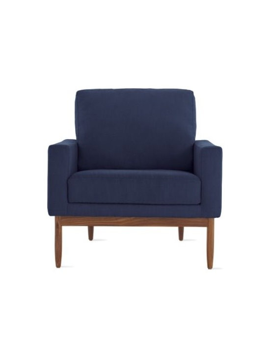 Design Within Reach - Raleigh Armchair | Design Within Reach - Raleigh (2009) is a comfortable, modern collection that draws from mid-century Danish design. Wrapping around the back of this Armchair is a solid walnut frame (be sure to click on Additional Views to see it) that brings visual lightness and satisfying aesthetic tension to the design. There's also a very functional reason for the way that this frame triangulates to the back of the Chair. Namely, that it permits a gracefully canted and ergonomic seatback while still solidly supporting you as you relax and unwind. DWR Design Studio chose to work with Jeffrey Bernett and Nicholas Dodziuk on this project because of the importance they place on people – how they move, interact, live, and most of all, sit. Made in U.S.A. Best of Year! The Raleigh Collection received Interior Design magazine's top honor for 2010 in the residential lounge category. The angled, high back comfortably supports your upper body. Visible from the side and back, this Armchair is cradled in a solid walnut frame. Down-blend filled back cushion has a removable cover for cleaning.DWR Exclusive.