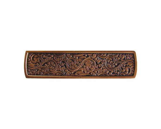 """Inviting Home - Saddleworth Pull (antique copper) - Hand-cast Saddleworth pull in antique copper finish; 3-7/8""""W x 7/8""""H; Product Specification: Made in the USA. Fine-art foundry hand-pours and hand finished hardware knobs and pulls using Old World methods. Lifetime guaranteed against flaws in craftsmanship. Exceptional clarity of details and depth of relief. All knobs and pulls are hand cast from solid fine pewter or solid bronze. The term antique refers to special methods of treating metal so there is contrast between relief and recessed areas. Knobs and Pulls are lacquered to protect the finish. Detailed Description: The Saddleworth pulls and the Saddleworth bin pulls both look intricate and interesting. The pulls are rectangular shaped while the bin pulls have a bit more of a dome look to them. They both can be used with the Saddleworth knobs. You may use the knobs on the doors the pulls on the smaller drawers and the bin pulls on the larger or wider drawers. That way you will get a variety of shapes and sizes while still keeping to the same design."""