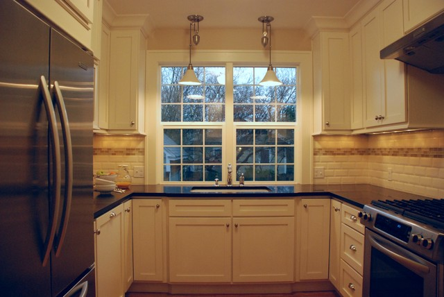 Traditional kitchen featuring cream painted shaker cabinetry traditional kitchen