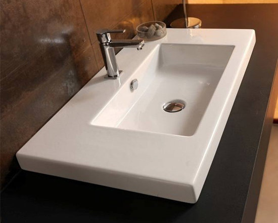 "Tecla - Beautiful Modern Wall Mounted, Vessel, or Built-In Ceramic Bathroom Sink - Tecla designs and manufactures this beautiful white ceramic bathroom sink in Italy. This wide rectangular sink can be installed as either a wall mounted, above counter vessel, or drop-in sink. Overflow is included and it comes with the option of a single faucet hole (as shown), no holes, or 3 holes. Sink dimensions: 39.37"" (width), 17.72"" (depth)"