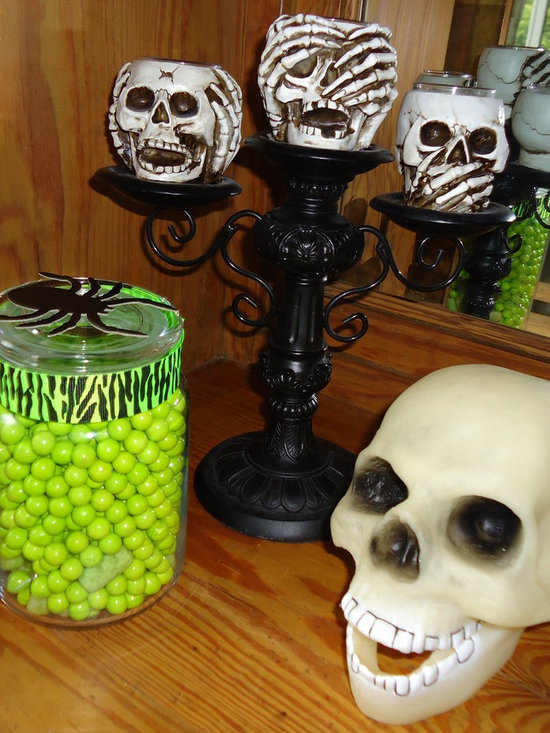 Halloween tablescape and hutch - Turn an old hutch into a fun, contemporary Halloween display by using Black & White acessories with a shock of green!