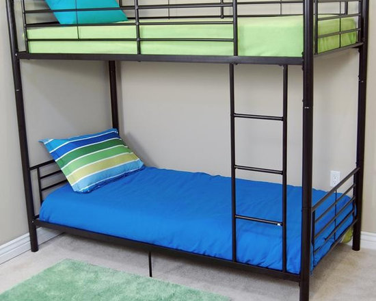 Black Sunset Twin-Twin Bunk Bed - The sturdy construction of this stylish contemporary bunk bed to the latest consumer product safety standards. Great for any space-saving design needs. Unlike other twin bunk beds, this bed also converts into 2 twin beds.