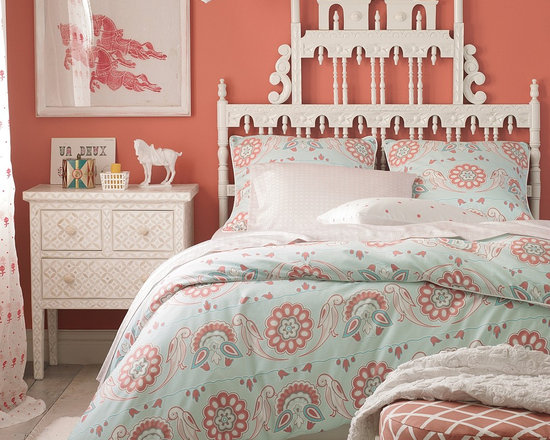 Annabel Duvet - Annabel's large-scale pattern is inspired by traditional French and Indian motifs. Detailed with fabric-covered button closures and white piping.