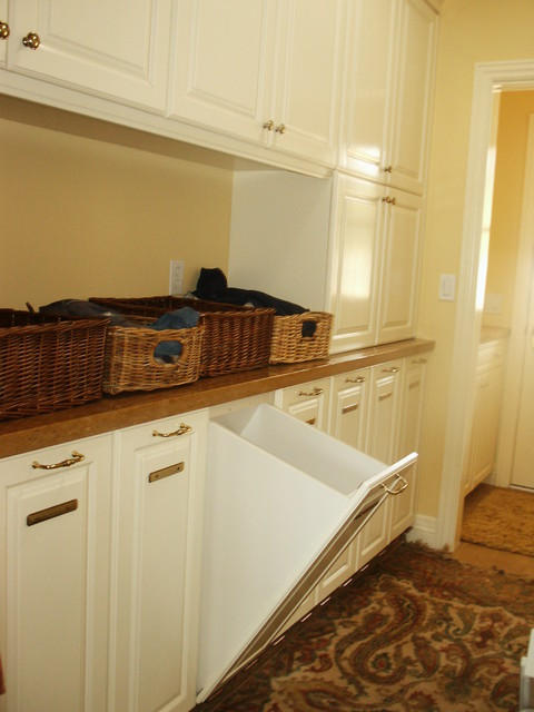 Laundry Room with pullout hamper traditional laundry room