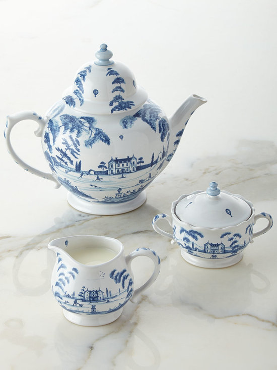 """Juliska - Country Estate Delft Blue Teapot - JuliskaCountry Estate Delft Blue TeapotDetailsCeramic stoneware teapot.Oven microwave dishwasher and freezer safe.15.5""""W x 12.25""""D; holds 2 quarts.Made in Portugal.Designer About Juliska:Introduced by Dave and Capucine Gooding in 2001 the Juliska collection of elegant European-inspired tableware reflects the couple's appreciation for historical design. Beyond dinnerware flatware stemware and decorative tabletop accessories today the Juliska collection includes designs for the office and bath."""