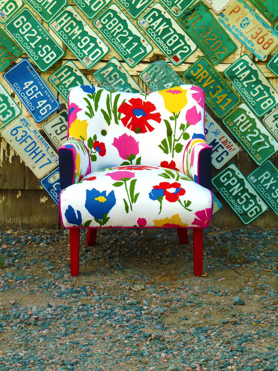 Vintage Flower Art Deco Chair - This very cool Art Deco vintage chair has been covered in a large vintage floral pattern. The sides have been covered in a subtle masculine blue and white pinstripe fabric. The chair lines are highlighted with a pink welt cord. The outside back has been covered in an ivory canvas and the legs have been painted a wonderfully spunky fire engine red!