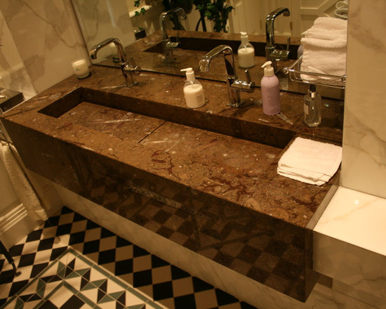 """Calacatta Cloakroom - Calacatta Oro marble surround framing the """"floating"""" vanity fabricated from a beautiful Brown Fossil marble."""