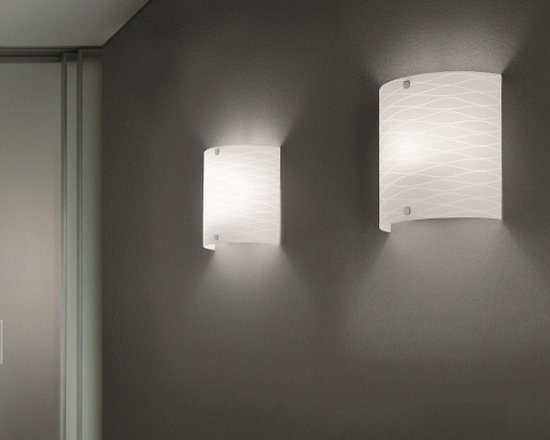 Class Wall Lamp by Leucos - Class Wall Lamp by Leucos. DIFFUSER Layered and blown glass, hand grounded. DIFFUSER COLOUR White satin finish. CONSTRUCTION White lacquered metal with chromed details. Class Wall Lamp by Leucos are designed by Ufficio Stile I Tre.
