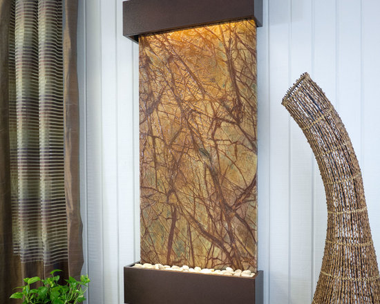 """Bluworld - Nojoqui Falls Classic Quarry Slate Fountain - Rainforest Brown Marble & Copperve - This Classic Quarry large Nojoqui Falls wall fountain will instantly become the crowning jewel of any room you put it in, whether it's in your home or office. When you look at this fountain, your eye will be naturally drawn to the movement of the water over the stunning brown marble stone to the awaiting polished cream white river rocks. The calming effect of this sight and sound cannot be overstated.Rainforest marble is not technically a marble; it's a serpentinite, which is rock composed predominantly of one or more serpentine minerals and is known for its healing qualities. Due to its elegant smooth appearance similar to marble, it is often referred to as marble. The name """"Rainforest"""" comes from the distinctive veining that looks like tree branches or a """"rainforest jungle"""". This particular marble is very strong and characteristics in veining and movement will tend to vary greatly between stones. Rainforest brown boasts earthy shades of warm brown, lush gold, and gray. This stone has deep reddish brown and white veining.Bluworld HOMelements�� Classic Quarry Line also features your choice of premium metals, like brushed stainless steel, rustic copper with our signature hand-applied patina, or your choice of our standard colors like Black Onyx or Copper Vein trim kits. Remotely controlled dimmable, long lasting, warm white LED lighting highlights the beauty of the stone color and texture. A removable rock tray allows easy access to the pump and adjustable flow rate valve. Cream White River Rocks are included. This fountain can be customized with the logo of your choice.Natural stone varies in color due to the different hues of the natural particles that make up the product. All stones are natural and vary in color, intensity and veining. Photos are provided as an indication only. It is the variation in natural stone that makes each fountain quite unique. Since this product """
