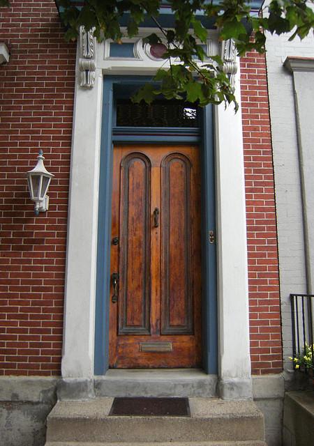 Custom radius 2 panel solid wood front door for Mediterranean style front doors
