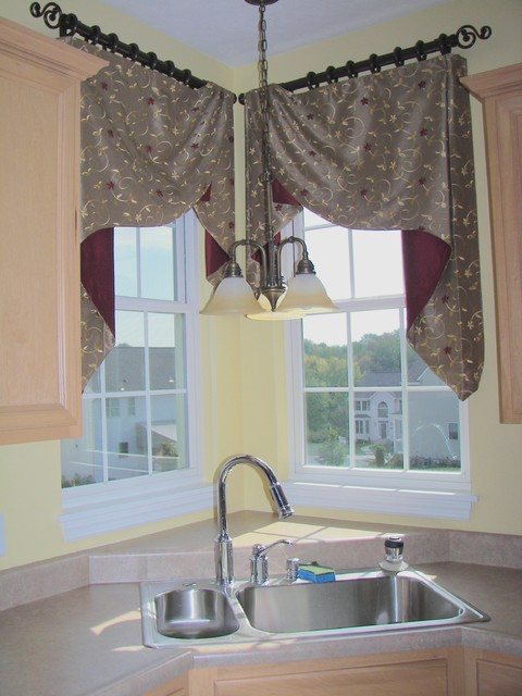 Window treatments corner of living room of a cottage style home lime
